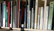 library shelf with  the spines of books and publications visible