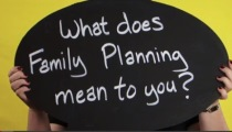 'What does Family Planning mean to you?' on round chalkboard