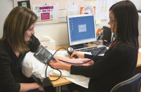 A blood pressure check is often part of a sexual health check-up.
