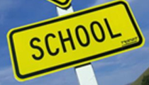 A traffic sign saying 'school'