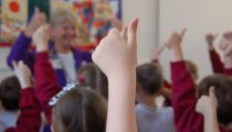 children's hand up in classroom